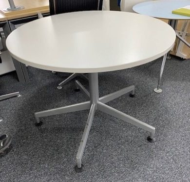 Steelcase circular meeting staron aluminium 5 star base with white laminate top.