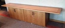 Credenza, 3000 x 610, oak veneer top with walnut veneer inlaid around edge of top, with two double door cabinets beneath