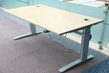 Electric height adjustable desk, 1600 x 800, beech top with grommets, silver frame