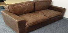 2 seat brown leather sofa (May need reupholstering)