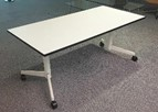 Flip top meeting table, 1600 x 800, white top with black edging, white frame on black casters